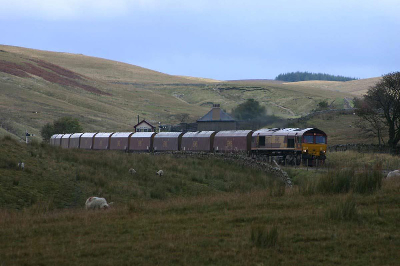 EWS class 66 with a southbound MGR passing Blea Moor signal box, 9th October 2004.  Image supplied by Ewan Tait