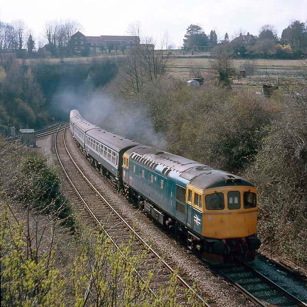 33013 with a Waterloo bound train leaving Fisherston Tunnel, Salisbury.  March 1986.  Agfachrome 100, Rolleicord 5A.  Image supplied by Chris Nevard.