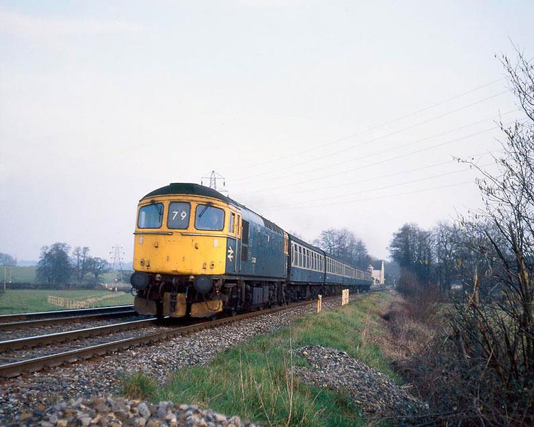 33029, Dunbridge (Hants) with what I imagine is a Portsmouth to Bristol train.  Early 1987.  Rolleicord 5A, Ektachrome 200.  Image supplied by Chris Nevard.