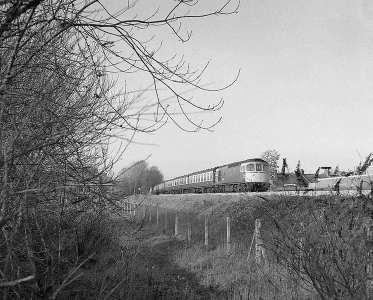 33xxx on a Bristol (or even Cardiff) to Portsmouth working.  Site of Salisbury MPD.  Late autumn 1983.  Rolleicord HP5.  Image supplied by Chris Nevard.