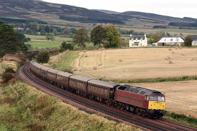 47854 slows for the station stop at Gleneagles where the passengers of The Wee Dram tour will disembark. The stock was booked to run to Perth ecs and then on to Millerhill. 17th October 2004.  Image supplied by Peter Kellett.