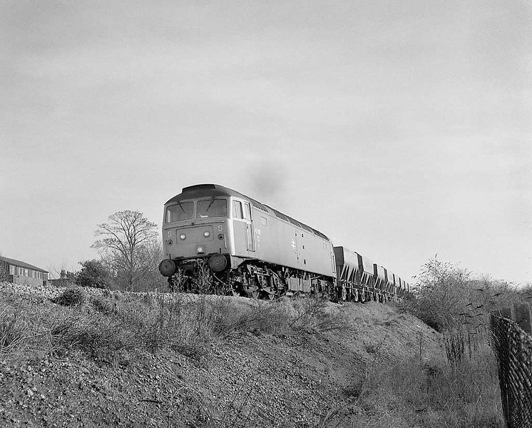 47152 on a westbound stone train passing the site of Salisbury MPD.  Late autumn 1983.  Rolleicord HP5.  Image supplied by Chris Nevard.