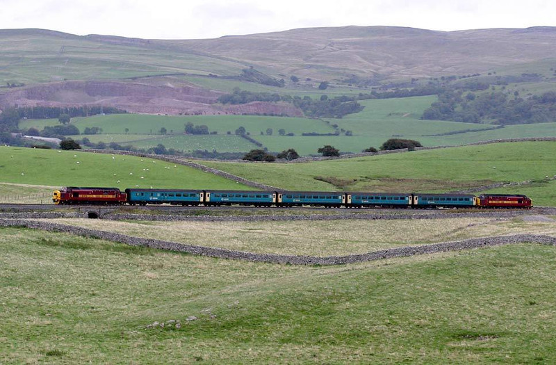 37408/411 disappear towards Kirkby Stephen at Waitby with the final Arriva loco hauled, 25th September 2004. Image supplied by Peter Kellett