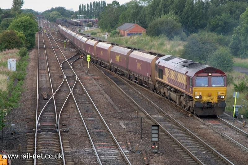 66168 starts its empty coal train out of Milford Junction Yard passing the site of Monk Fryston station. Image supplied by Marcus Dawson.