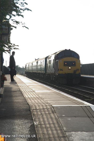 37 411 Under the watchful eyes of an early morning commuter, 37411 pauses at Kirk Hammerton, for an eastbound unit. Image supplied by Marcus Dawson.