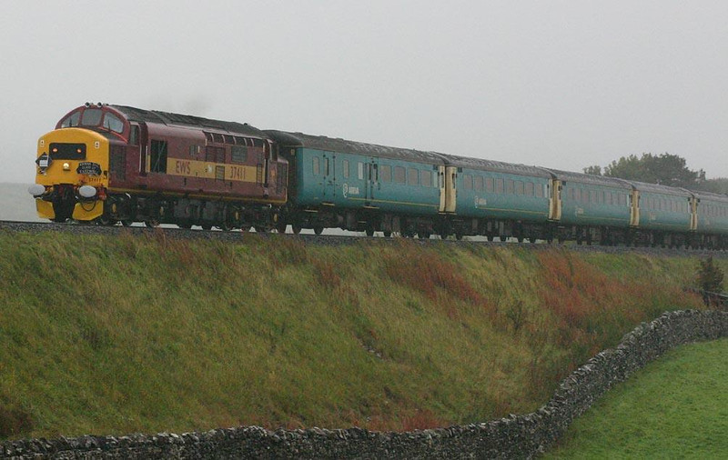 37411 at Selside coming out of the mist with the final York-Carlisle loco hauled service, 25th September 2004. Image supplied by Peter Kellett