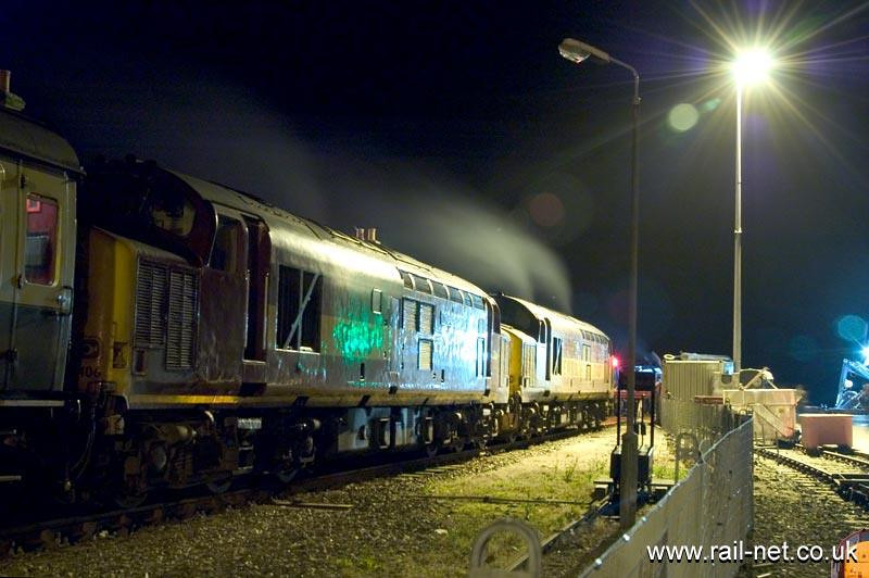 """Following the failure of 40145 a pair of 37s subsitiuted on """"The Northern Lights"""" railtour to Kyle. Here the pair [37427/406] Enoy the fresh night sea air at Kyle at 03:30. Image supplied by Marcus Dawson."""