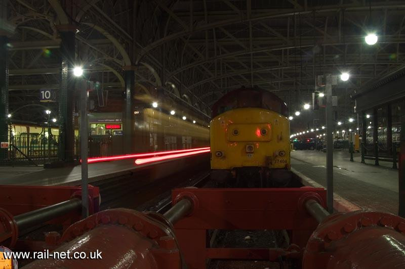The light trail of 156466 as it departs Glasgow Central besides 37406. Image supplied by Marcus Dawson.