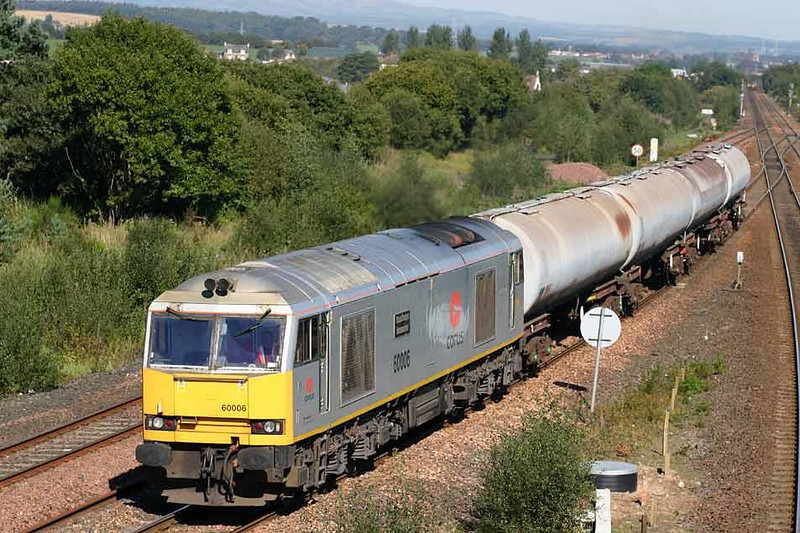 60006 takes four TEA tanks towards Mossend from Grangemouth at Greenhill Lower Junction, 08th September 2004. Image supplied by Peter Kellett