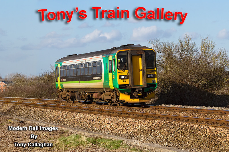 1st Mar 14: 153333 working 2M58 the 14.36 Swindon to Westbury runs behind the White Horse Business Park at Yarnbrook