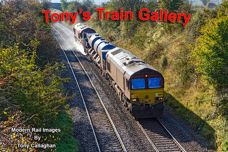 """14th Oct 2020"""". Dropping down the 1 in 70 grade through Upton Scudamore  are 66155 & 66151 as they work 3J12 from Par to Westbury that includes the out ansd back to Salisbury.  After an hours break they will start the returmn trip to St Blazey.  The hand rail on the right was on the foot path from the bridge to track side for the signal man to access the Upton Scdamore Signal Box that was 2/300 yards beyond the distant bridge"""