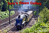 "The ""Dorset Coast Express"" to Weymouth with LNER A4 Pacific 60019 ""Bittern"" in charge rounds the corner at Pirbright"