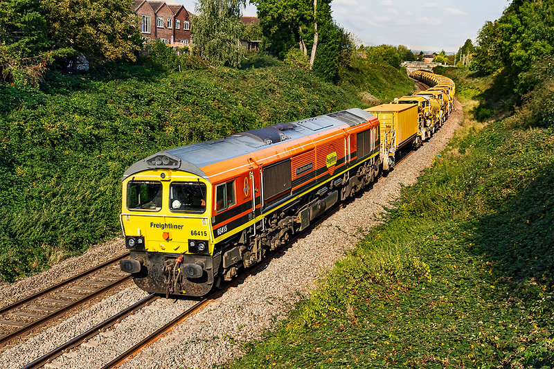 20th Sep 2020:  Pictured from Mud Lane as it leaves Trowbridge is 6Y15 from Oxford to Fairwater Yard in Taunton.   I was very pleased to see that 66415 'You Are Never Alone' was on the front and that 66953 was on yje other end.   It was running 16 minutes early at Melksham but was held at Bradford Junction for nearly 15 minutes for no apparent reason which meant that the sun had moved another 4 degrees making it a bit more head in than I had hoped.