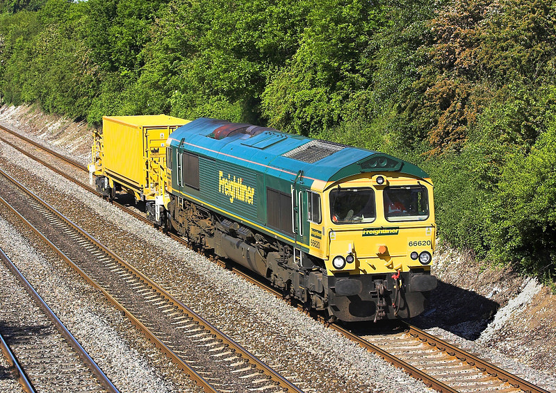 3rd Jun 06:  66620 trundles East with part of the High Output Ballst Cleaner