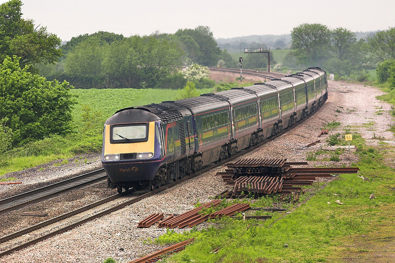 28th May 06:  Another HST charges East and is about to pass the site of Uffington Station