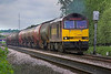 25th May 06:  60080 has half the train out onto the main line as it heads the empty Murco tanks back to Robeston  Theale  25/05/06
