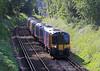 24th Jun 06: Sunlight dapples 450098 as it departs Sunningdale for Waterloo