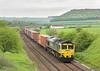 6th May 06:  66538 Powers through Norton Bavant with the 4O14 Garston to Southampton