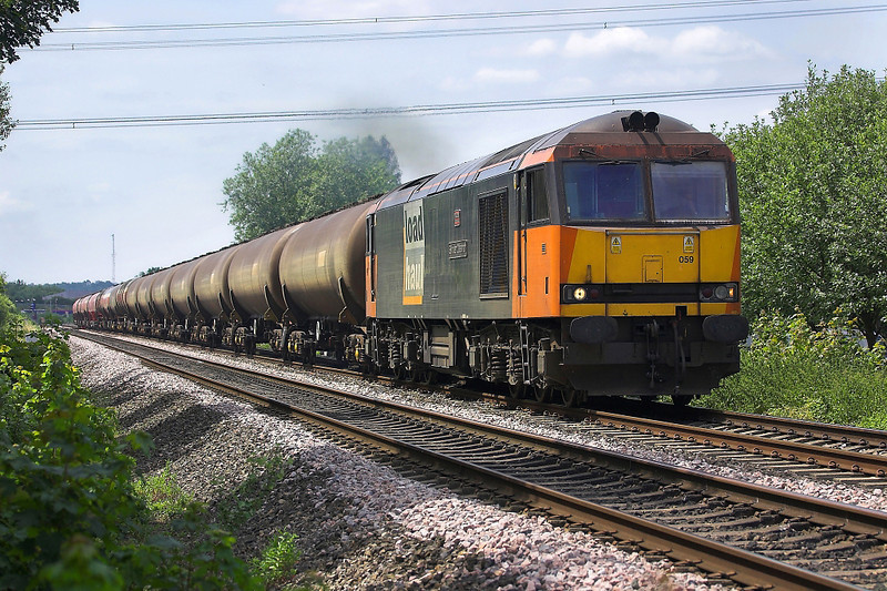 22nd Jun 06:60059 still in full Loadhaul livery moves away fron Theale with Murco empties for Robeston