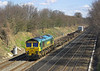 8th Apr 06:  66537 heads west at Milley Bridge with a diverted  Freighliner to Southampton