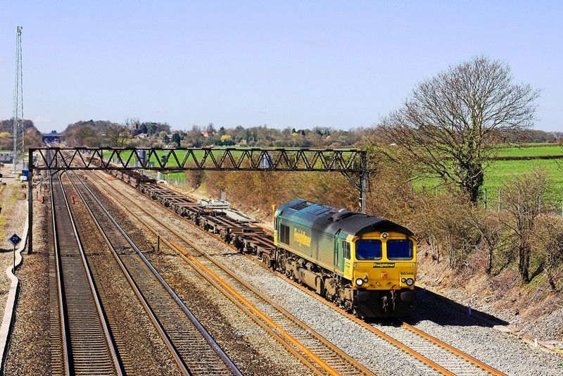 8th Apr 06: 66568 on the 'UP Slow' at Milley Bridge with  a diverted liner service from Southampton