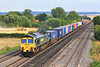 8th Aug 06:  Harvesting continues apace as 66537 passes with 4M99 Southampton Millbrook to Trafford Park