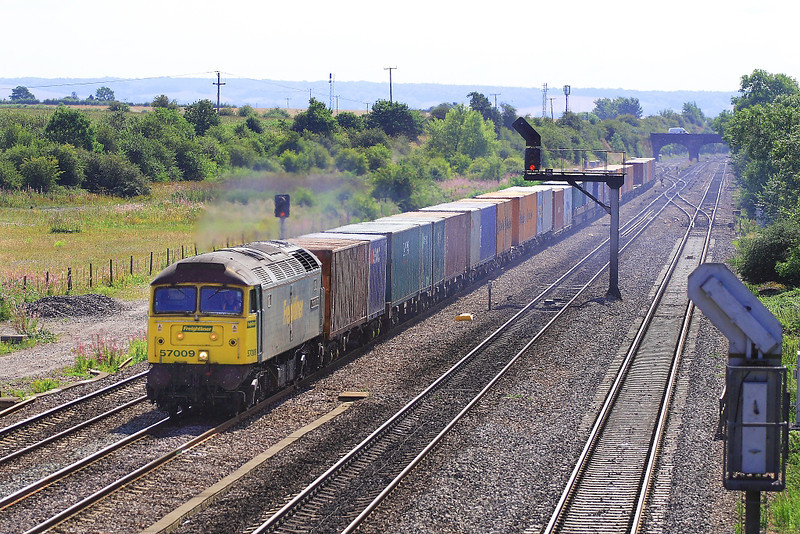 8th Aug 06:  57009 rumbles past the site of Moreton Cutting yard  going to Lawley Street from Southampton