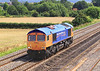 8th Aug 06:  Metronet Livery on 66722 catches the sun as it passes Cholsey Manor Farm