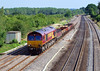 8th Aug 06:  66245 at the site of Goring water troughs with 6V27 Eastleigh to Hinksey returning Engineers working.  Lower Basildon