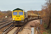 5th Dec 06:  66622 hauls 6O49 the Neasden to Wool sand empties up onto the main line from the Chertsey loop.  Byfleet & New Haw
