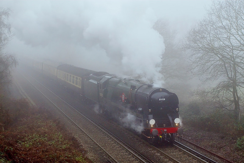 21st Dec 06  As the fog thickens again 35028 Clan Line opens up as it passes Trumps Mill Lane. The VSOE Surrey Hills Luncheon Express is running from Victoria via Guildford and Redhill and back to Victoria
