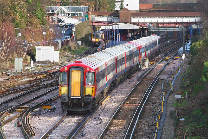 12th Dec 06:  Rushing through Weybridge 442404/422 form 1B33 the 12.05 Waterloo to Poole