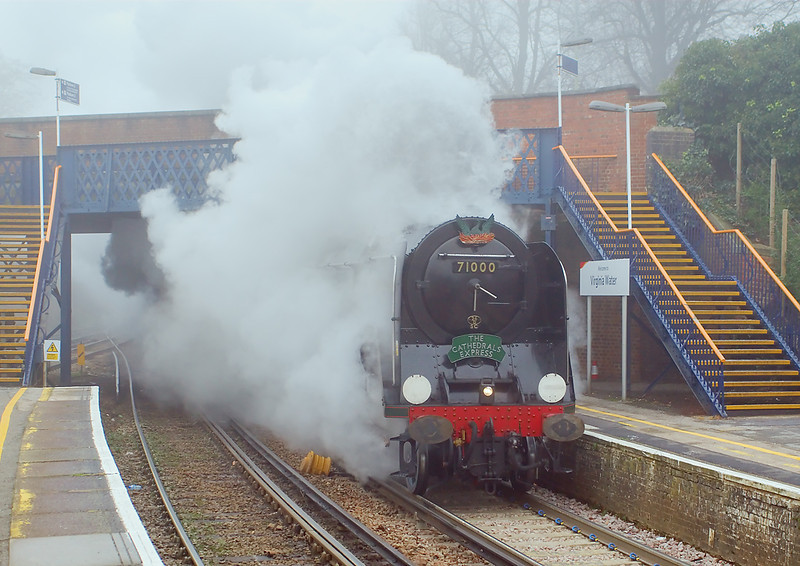 21st Dec 06:  71000 Duke of Gloucester blasts under the bridge and into Virginia Water station. The Cathedrals Express was travelling from Victoria to Winchester. Patrons were to enjoy a private Carol concert in the Cathedral