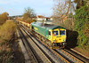 12th Dec 06:  66622 brings the Neasden to Wool sand empties across Addlestone Moor.