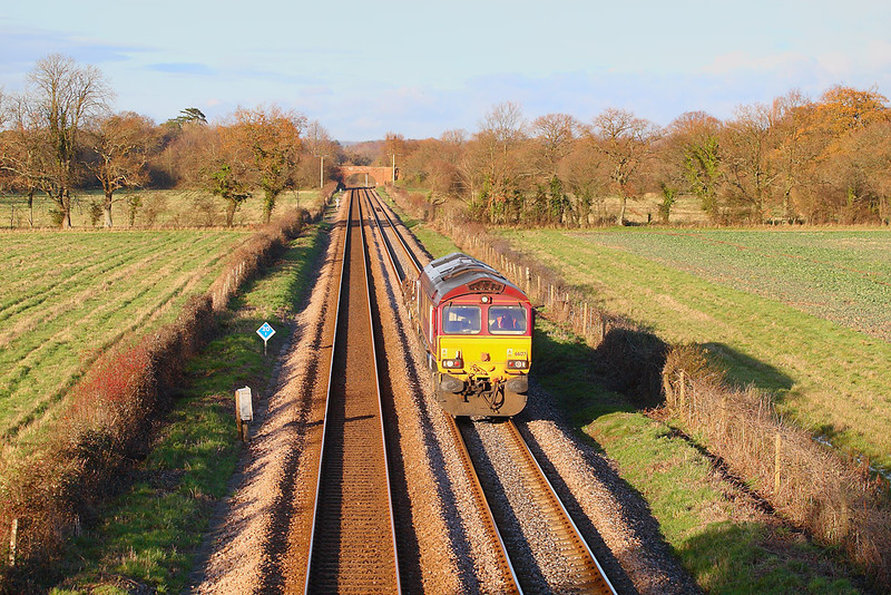 9th Dec 06:  With the low sun highlighting the neatly manicured track 66127 passes Lee with the Hinksey to Eastleigh Engineers