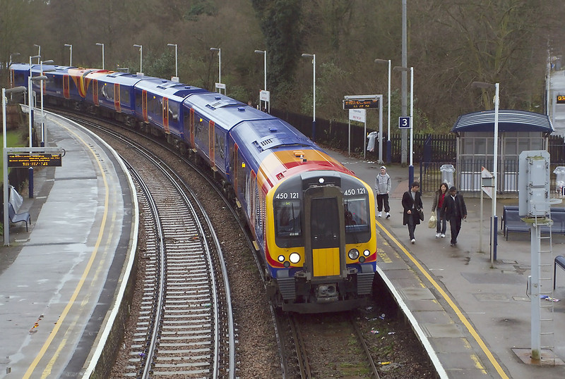 7th Dec 06:  With the destination blind reading 'SWT' 450121/064 rests the 09.07 from Waterloo to Reading  in platform 3. It will draw forward and reverse into platform 2 before continuing to Reading. The line through Staines being closed for engineering work.