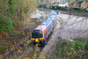 12th Dec 06:  Even when the leaves have fallen the branches sill get in the way.  450014 departs Weybridge for Waterloo via the Hounslow Loop