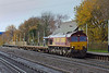 5th Dec 06:  66041 brings 3 Salmon wagons through the station. They make up 6Y42 Eastleigh to Hoo Junction engineers.   Byfleet & New Haw
