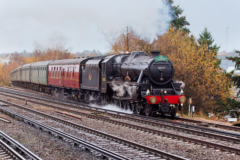 5th Dec 06:  With the sanders working overtime 45132 heaves the Cathederals Express onto the main line. It was also running from Victoria to Salisbury and then on to Westbury.    Byfleet & New Haw