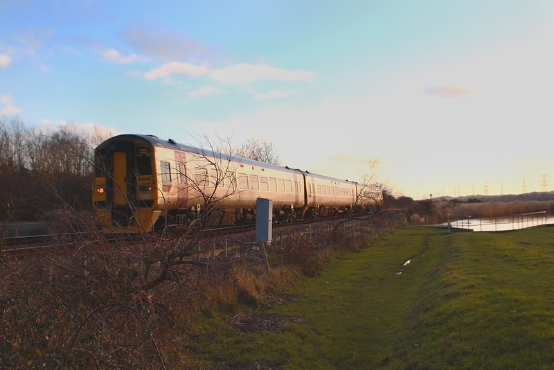 9th Dec 06:  158966 catches the last of the light as it heads north from Redbridge