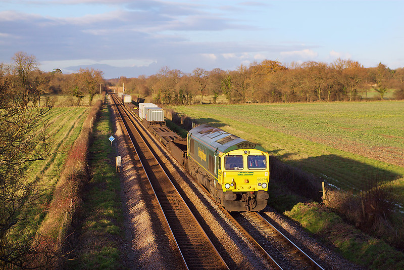 9th Dec 06:  In beautiful light 66574 hurries the Air Express from Ditton through Lee