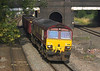 4th Jul 06:  66180 with empty coal boxes bursts from under the station bridge