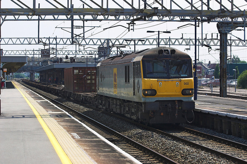 4th Jul 06:  92002 H G Wells, 4H24 from Wembley to Trafford Park slowing to cross to the slow line