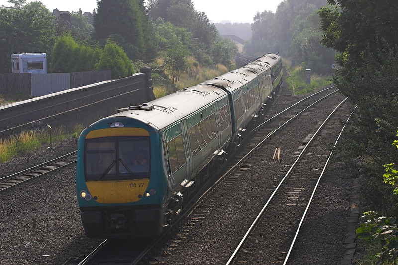 h Jul 06: 170117 with a pair of Sprinters in tow races through with  a Cardiff service