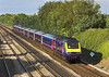 23rd Jul 06: In beautiful evening light 43025 has 3 of the new livery coaches in the set.  Shottesbrooke