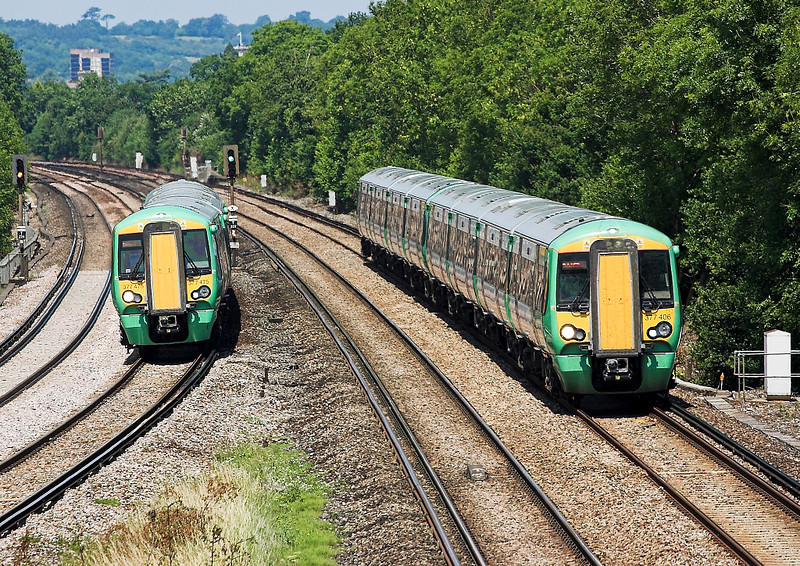 2nd Jul 06:  77406 overtakes 377475 as it slows for the Salfords stop