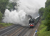 9th Jul 06 06:  71000 Duke of Gloucester accelerates gently away with The Cathederals Express from Clapham Junction to Exeter