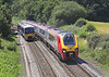 15th Jul 06:  A northbound Super Voyager passes 165129 on the Reading to Basingstoke shuttle