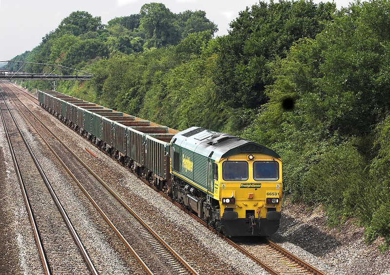 27th Jul 06: 66531 heads 6Z93 Cardif Tidal to Hitchen empty scrap. Running over 2 hours late. Shottesbrooke