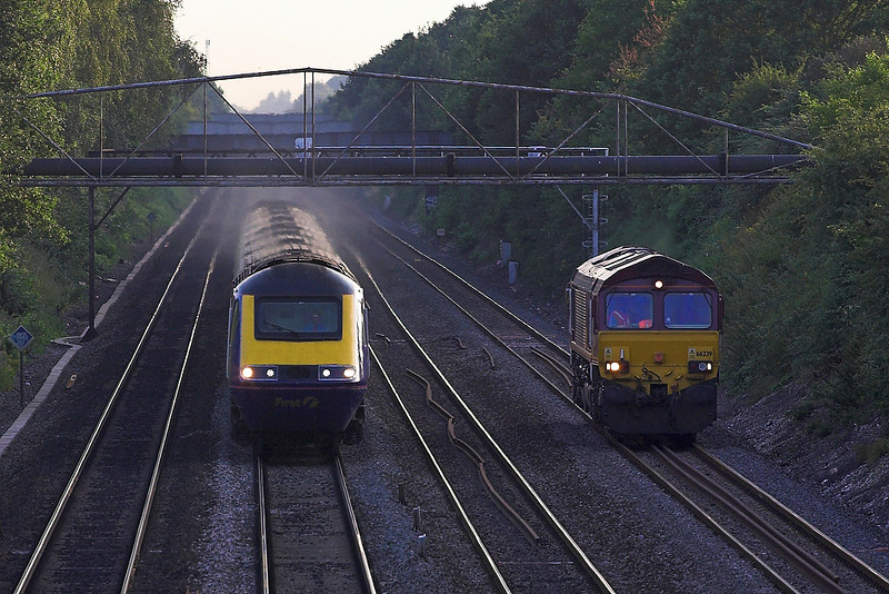 23rd  Jul 06: With no traffic 66239 plods up the relief from Margam to Wembley as an HST overtakes
